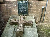 This Cross, which formerly adorned the north gable of the Barony Church in Commercial Street, is placed here as a symbol of the healing of the schisms caused by the Secession in 1781 and the Disruption of 1843, through the re-union of the congregations in Alyth Parish Church in 1977.